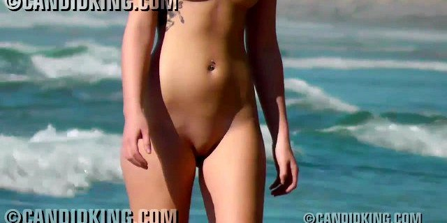 Candid young blonde naked on the nude beach in public!