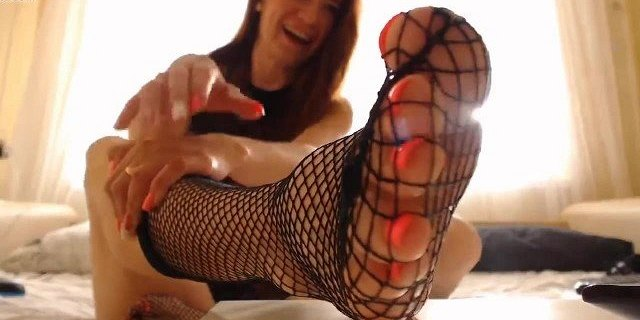 Sexy Girl Showing Feet in Nylon Fishnets