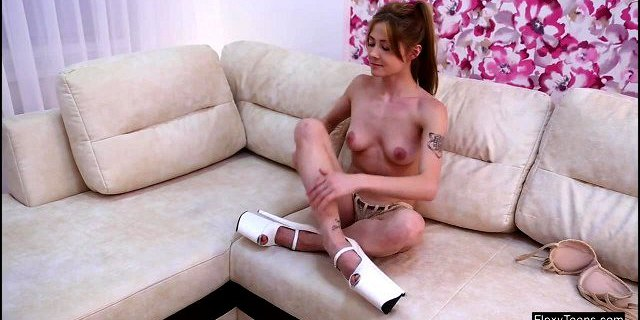 SKINNY teen swirls on the couch