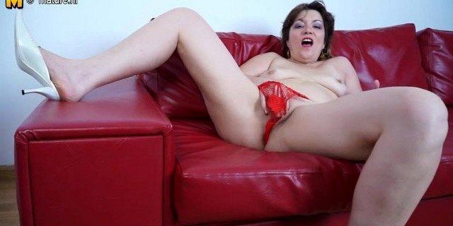 Mature mother riding a dildo on her couch