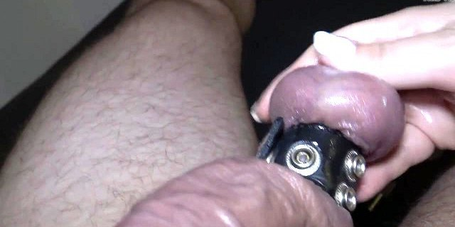 Teasing his cock and balls with leather harness
