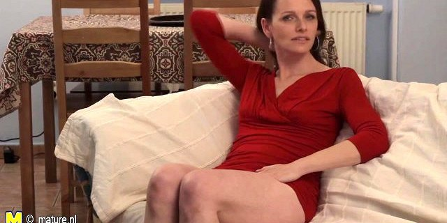 Naughty mother masturbating on the couch