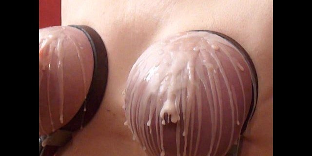 Hot dripping wax on her tits