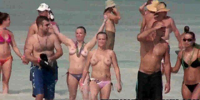 Group of college babes showing their tits at the beach