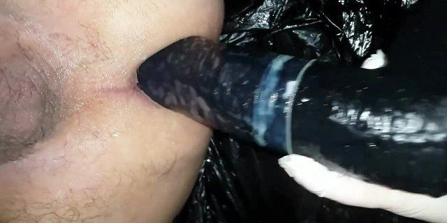 Mistress J practices with the small black strapon agina
