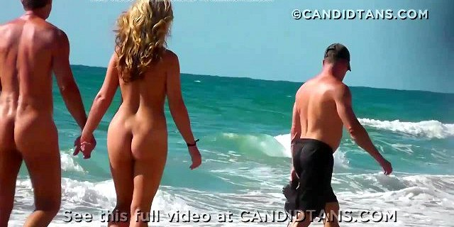 Milf mom naked on the nude beach showing shaved tan pussy!
