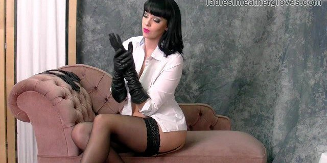 Babe with big tits in nylons and leather gloves fetish tease