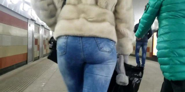 Nice round ass in tight jeans in winter