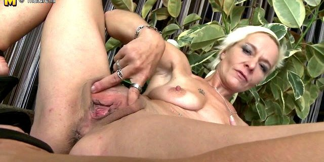 Slim mature mom with small saggy tits and dildo