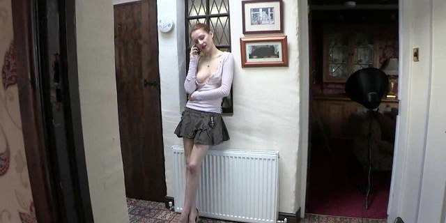 downblouse phoning in the hall
