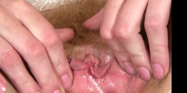Filthy Red Head MILF wanks her hairy cunt