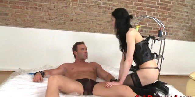 Lingerie femdom rubs pussy on tied subs cock