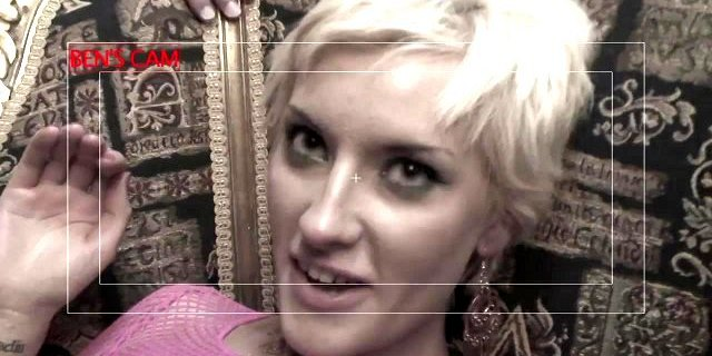 PIxie haired blonde in hot pink fishnet bends over to suck cock