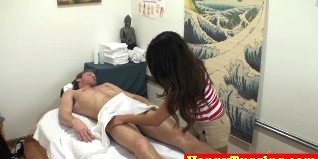 Bigtitted asian masseuse jerking and sucking