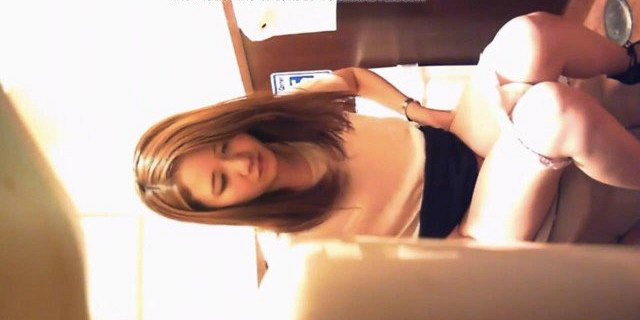 Pretty Chinese Girl in Toilet