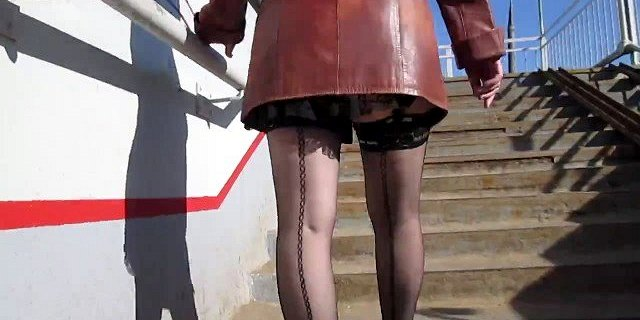 Sexy girl in seamed stockings going upstairs 4