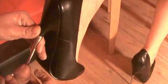 high heel and stick into penis