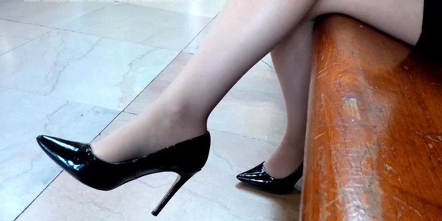 Business lady in pantyhose and black high heels
