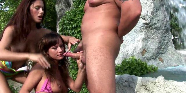 Two hungry brunettes bang a hot stud by the pool
