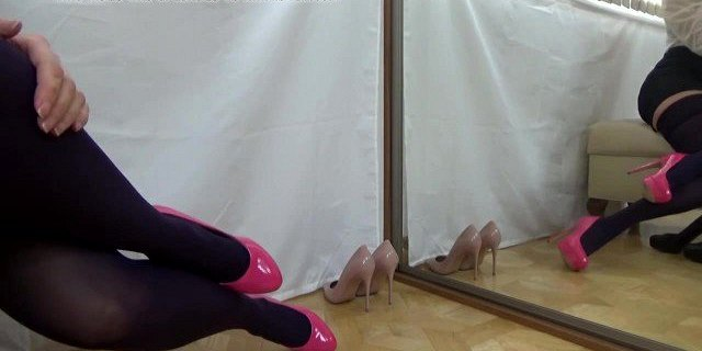 Pink high heels and black stockings in mirror