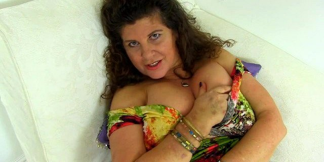 Milf Gilly from the UK teases us with her big tits