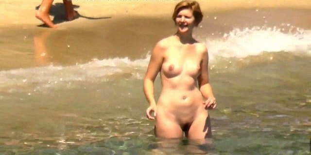 Naked chubby blonde plays ball on the beach