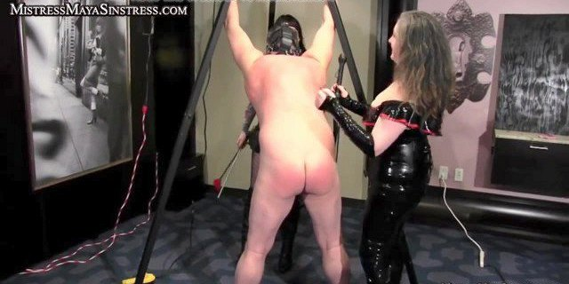 Mistresses humiliate male slave in Femdom action
