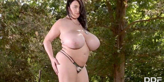 Leanne Crow plays with her Monster Juggs in Commando gear