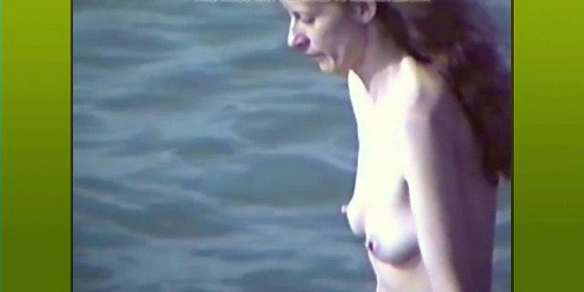 Topless with hard nipples at the beach