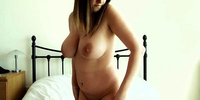 Lusty babe loves squeezing her big natural tits