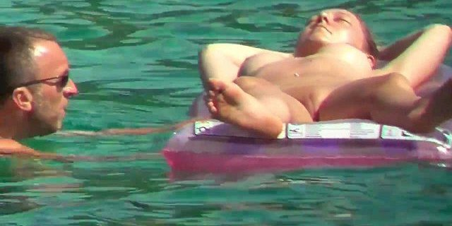 Pussy exhib nudist suntanning on water inflatable mattress
