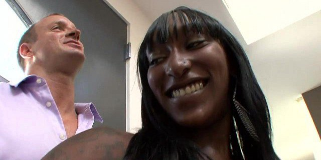 Chocolate skin bitch gets nailed doggy style by white stud