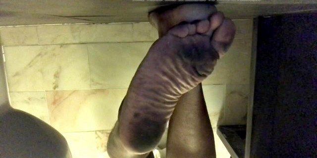 Dirty feet after walking around town with no shoes on