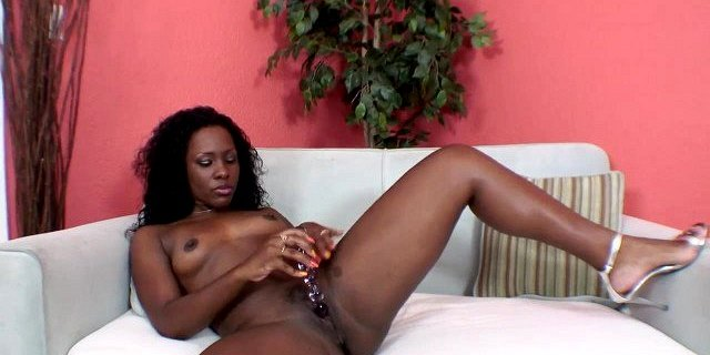 Ebony with small tits fucks herself doggy style with a toy