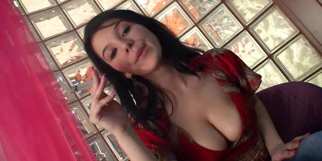 Hot brunette smokes two at once