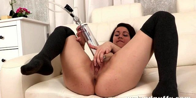 Petite brunette cutie plays with her sex toys