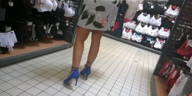 Slow mo - Nice woman with high heels looking for lingerie