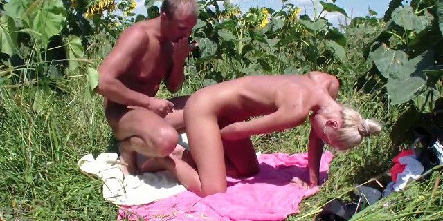 Lewd amateur couple strong orgasm in sunflowers field