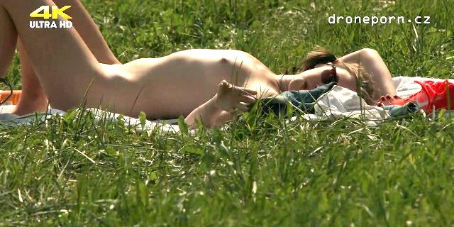 Young girl with small tits masturbating on the grass