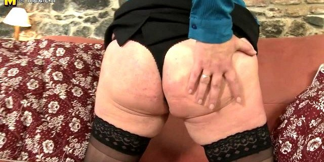 Naughty chubby housewife masturbating on her couch