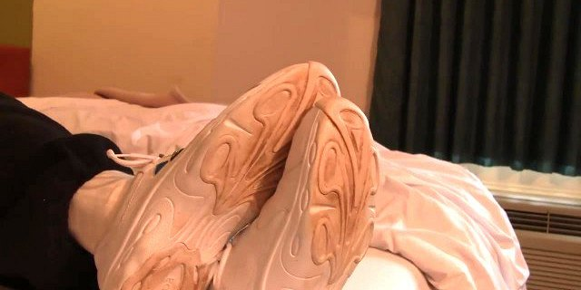 Fondling her cheerleading shoes and socked feet Preview