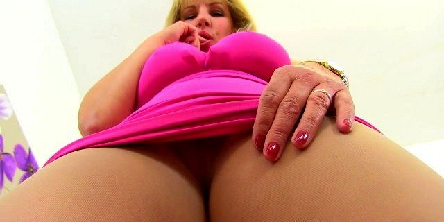 English milf Danielle dips her finger into her sweet cunny