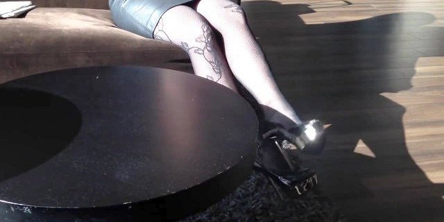 high heels and stockings in hotel lobby
