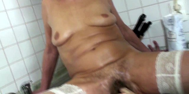 Girl fisting hairy granny on her kitchen