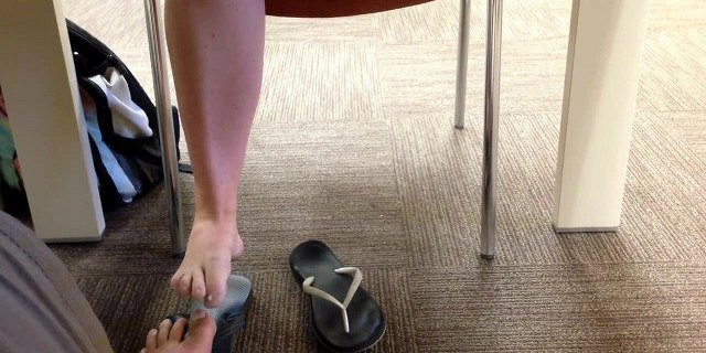 hidden footsie in library with  student she likes