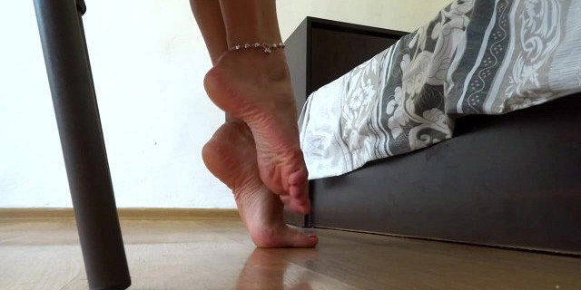 Foot fetish - highly arched feet close view