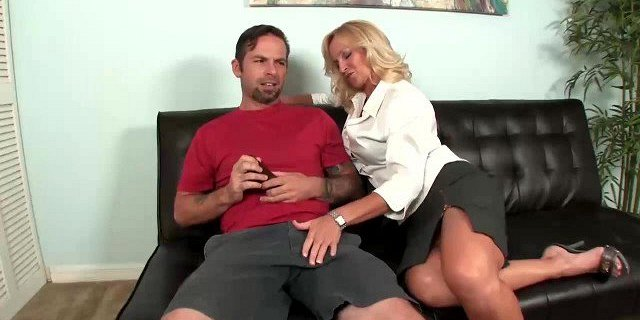 Busty slut jerking the young guy