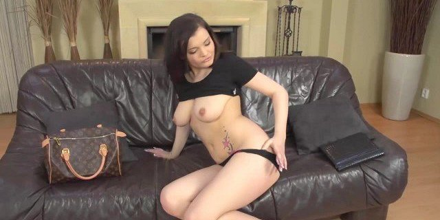 Brunette fingering on the couch