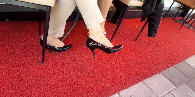 she dangles sexy high heels at lunch